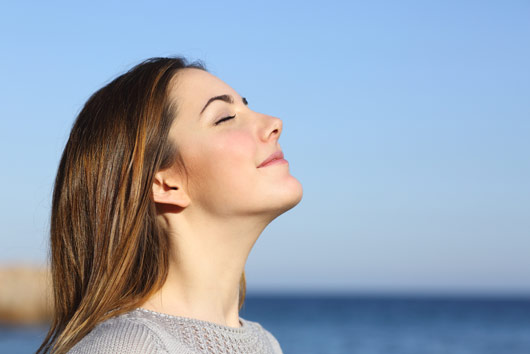 Woman practicing breathing techniques